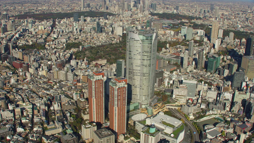 Tokyo, Japan circa-2018. Aerial view of Roppongi Hills Building. Shot from helicopter with RED camera. #1022610043