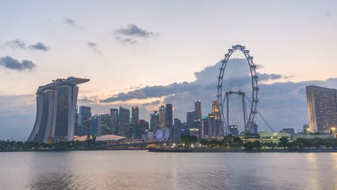 Singapore time lapse 4K, city skyline day to night motion time lapse (Hyperlapse) at Marina Bay waterfront business district
