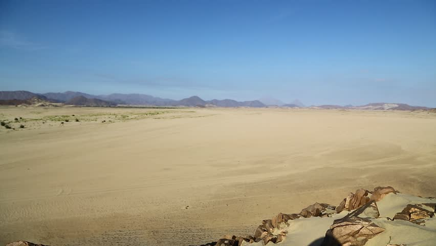 In the middle of the desert rock and track like concept of wild and nature scenic land   | Shutterstock HD Video #1022760643