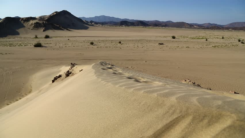 In the middle of the desert rock and track like concept of wild and nature scenic land   | Shutterstock HD Video #1022804953