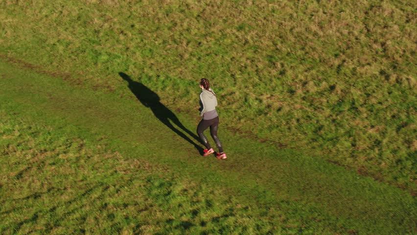 Aerial Shot, Tracking Shot of running jogging sporty girl woman | Shutterstock HD Video #1022825533