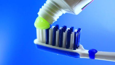 Toothbrush paste on toothbrush close up