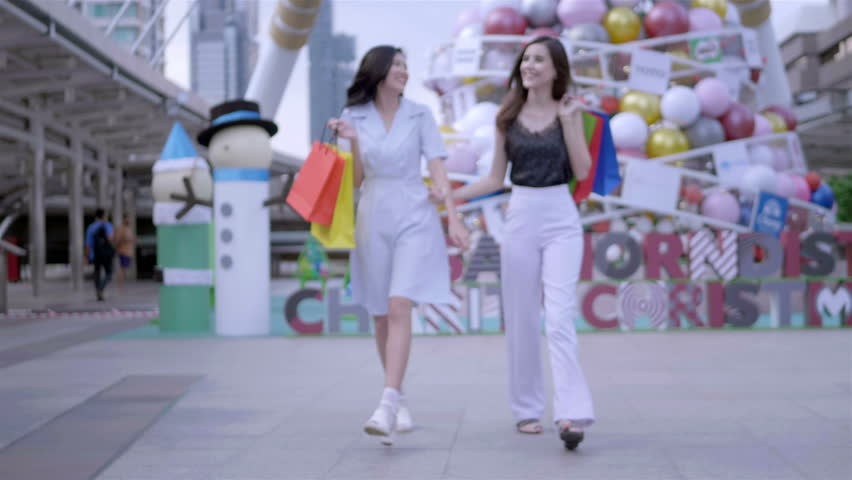 Beautiful woman with open shopping bags smiling happily walking in city centre Thailand. shopping, happiness and fashion Concept. Slow Motion | Shutterstock HD Video #1022861983