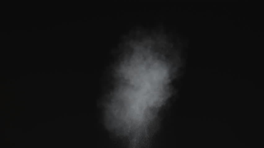 Dusty bullet hits on a wall with chunks of debris flying out .  Powder explosion on black background. Impact  dust particles. Dust explosion in front of black background, slow-motion close up. VFX  | Shutterstock HD Video #1022865373
