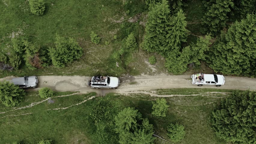 Travel. Cars On Mountain Road Between Green Trees Aerial View. Traveling Vehicles Driving In Nature | Shutterstock HD Video #1022883823