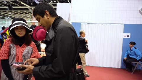 Wan Chai, Hong Kong - January 14, 2019 ; Business Buyers negotiate trade with seller exhibitors in Fashion Clothes Textile Design at HK Convention and Exhibition Center