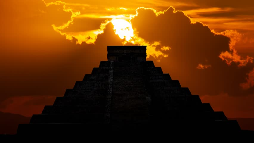Mayan pyramid ( Kukulcan Temple ) at Sunset, Time Lapse with Red Sun and Clouds, Chichen Itza, Yucatan, Mexico