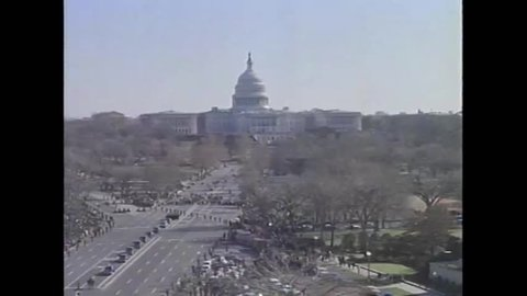 CIRCA 1963 - Aerial views show JFK's funeral procession from the Capitol Building, including his horse-drawn casket.