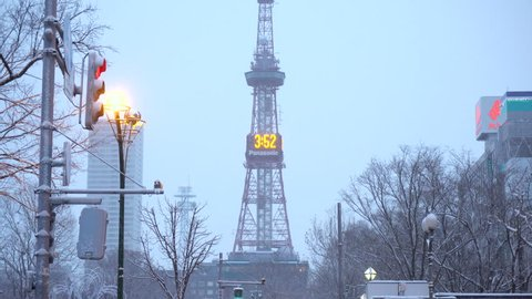 2 Clips - Tilting Up - Sapporo TV Tower Seen From Odori Park in Winter - Sapporo, Japan - December, 2018
