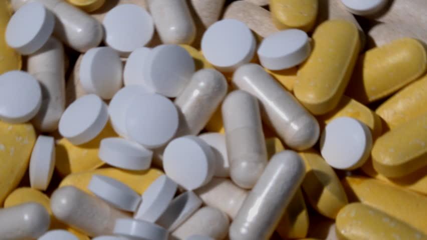 Vitamin pills close up healthy eating 4k | Shutterstock HD Video #1022979133