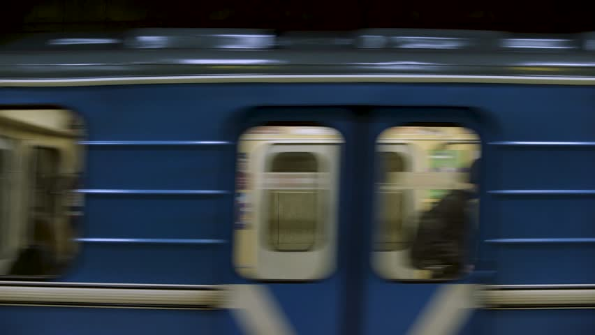 CINEMAGRAPH - Blue subway train with people inside moving fast, view from metro station. Close up for windows of subway train passing fast at underground station | Shutterstock HD Video #1022979223