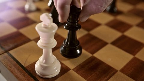 Black queen checkmates white king in chess game.