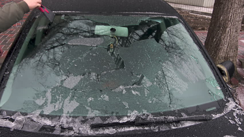 Ice scraping,Cleans frozen windshield in winter time | Shutterstock HD Video #1023069463