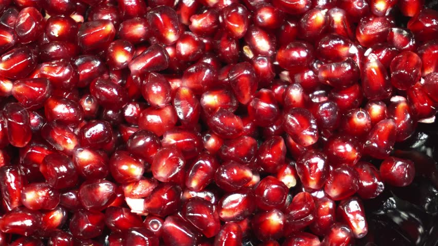 Slow rotation of fresh red pomegranate seeds | Shutterstock HD Video #1023097033