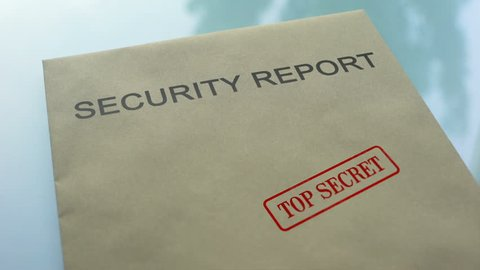 Security report top secret, stamping seal on folder with important documents