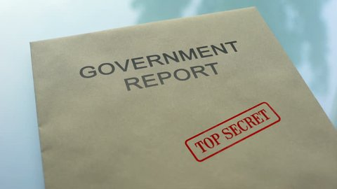 Government report top secret, stamping seal on folder with important documents