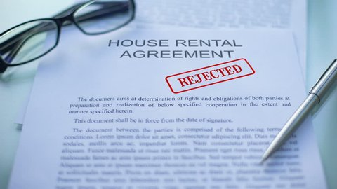 House rental agreement rejected, officials hand stamping seal, business document