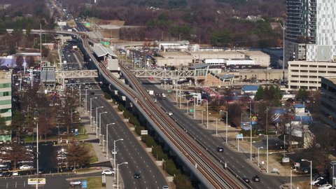 Tysons, VA / USA - December 27 2018: Aerial descent focusing on the Spring Hill Metro station and traffic on Leesburg Pike.