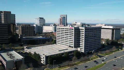 Tysons, VA / USA - December 29 2018: Pan from right to left showing banking offices and hotels in Tysons Corner, Virginia