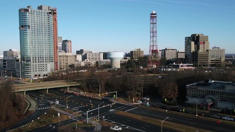 Tysons, VA / USA - December 29 2018: Slow reverse dolly showing the Tysons Corner skyline over the intersection of Leesburg Pike and Chain Bridge Road