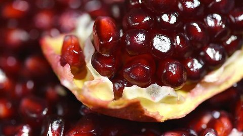 slow rotation of fresh red pomegranate seeds