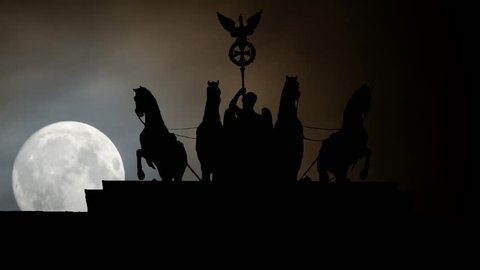 Berlin: Quadriga on Top of the Brandenburg Gate by Night, with Full Moon and Clouds, Germany, Europe