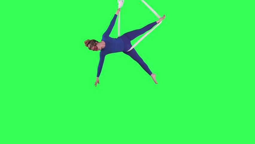 Acrobatic Tissue Artist performs wearing a blue suit over a green screen