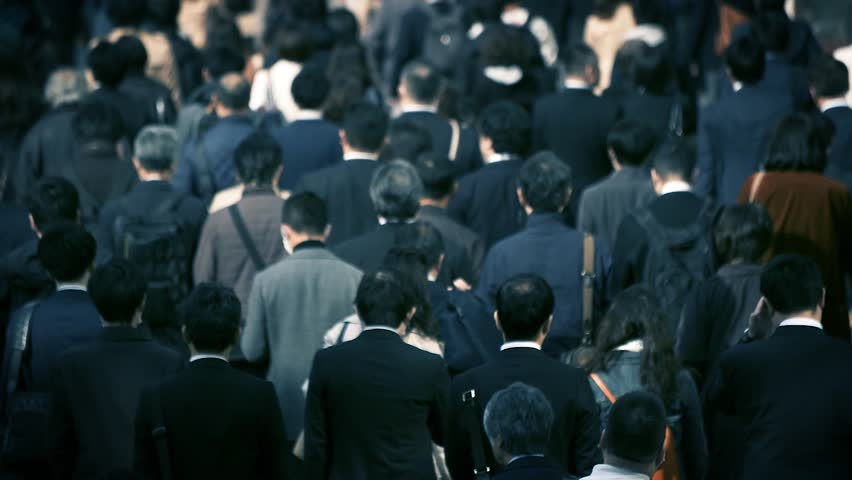 A crowd of Japanese businessmen at work