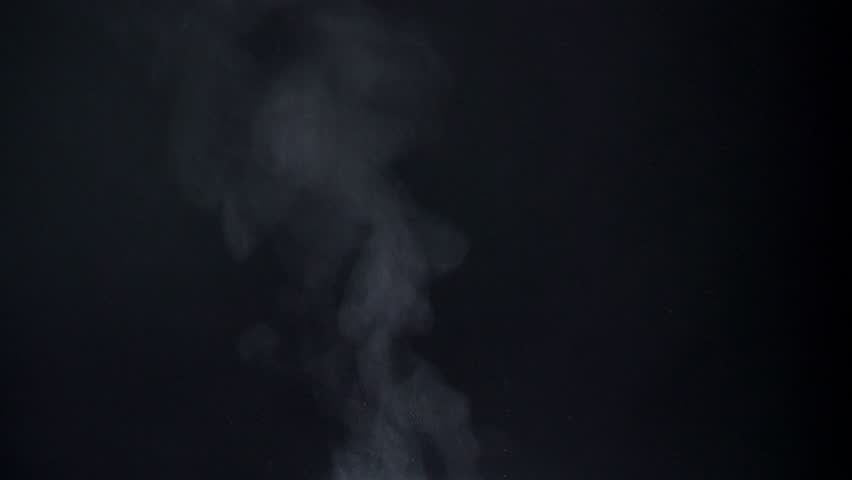 Closeup shot of vapouring fume flying on black background. | Shutterstock HD Video #1023379093