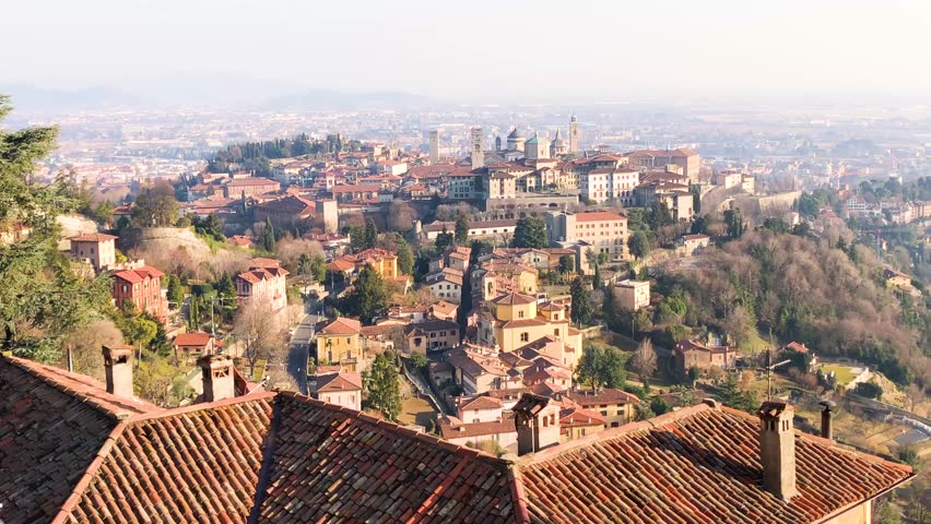 Bergamo Old city Citta Alta, One of the beautiful city in Italy, Lombardia, Landscape of the old city from San Vigilio hill during a beautiful day, 4k footage video. | Shutterstock HD Video #1023444793