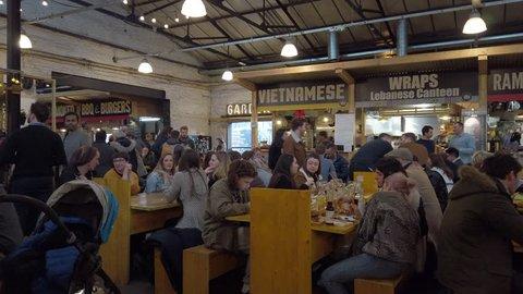 ELEPHANT AND CASTLE, LONDON - FEBRUARY 2, 2019: People inside Mercato Metropolitano food market in Elephant and Castle, London, UK.