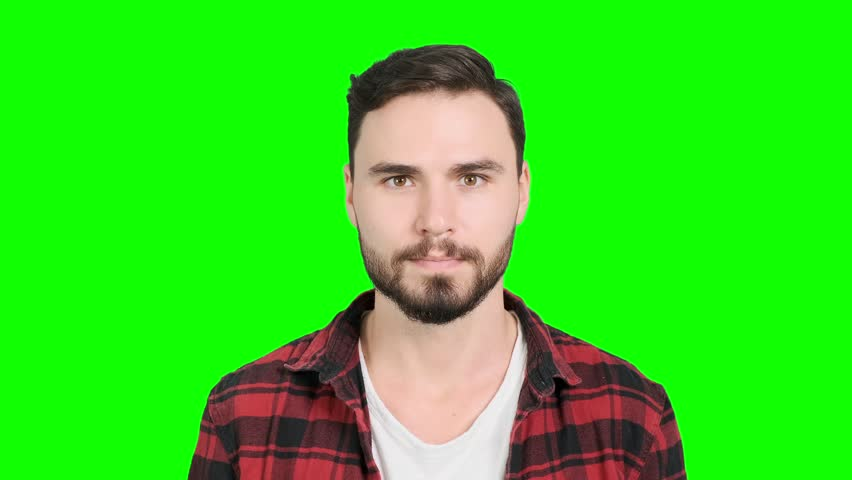 Young man acting extremely happy and surprise after big win on green screen. White male, chroma key. | Shutterstock HD Video #1023563293