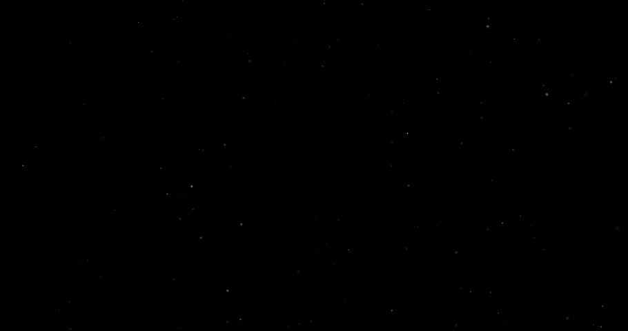 Flying dust particles on a black background | Shutterstock HD Video #1023599743