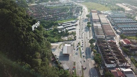 IPOH,MALAYSIA. FEBRUARY 5, 2019 : Aerial view of IPOH signage attach at mountain near highway Ipoh, Ipoh is a capital state of Perak Malaysia