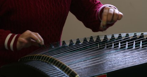 Practicing Chinese guzheng, Chinese Traditional Instrument