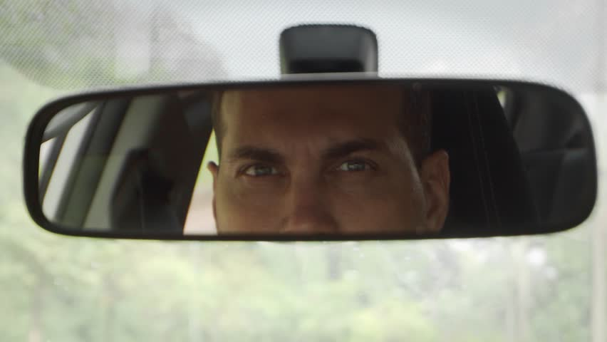 Young Caucasian Man Driving Car Looking in Rear View Mirror | Shutterstock HD Video #1023742183