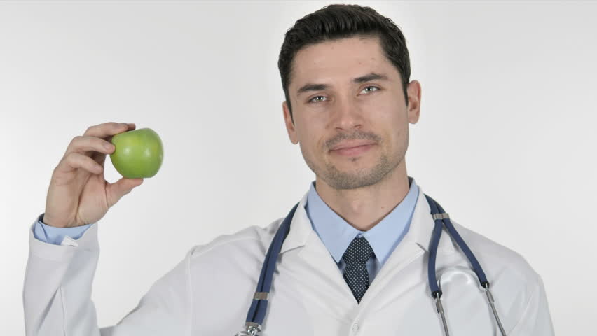 Doctor Showing Green Apple, Health Care #1023800473