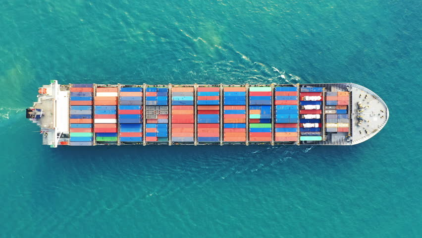 Aerial view of container cargo ship in sea. | Shutterstock HD Video #1023846823