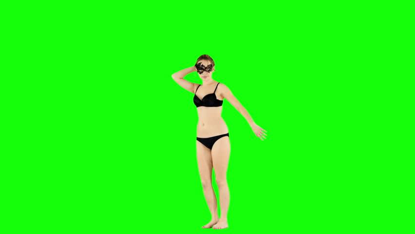 Cute Girl Sending Kisses and Dancing on Green Screen #1023983003