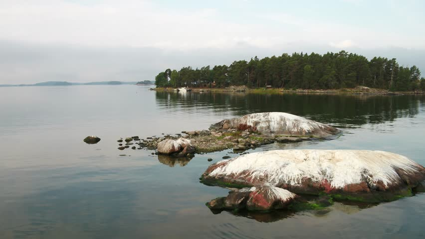 Low altitude areial shot of rocks, Archipelago Sea, Finland | Shutterstock HD Video #1024008293