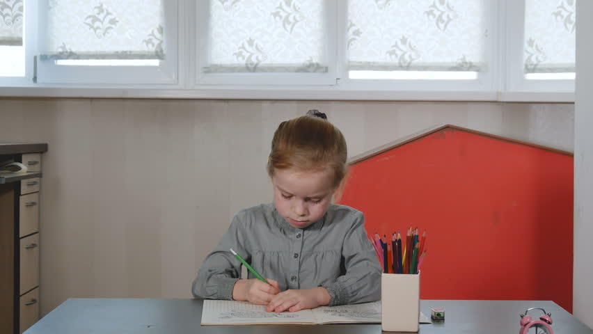 Smart little girl study at home, doing homework, preschool education. Daughter learning hard, mother brings tasty pancakes. | Shutterstock HD Video #1024071563