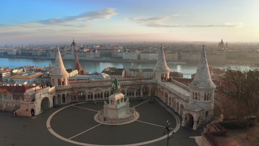 Budapest, Hungary - 4K flying over the famous Fisherman's Bastion towards River Danube with Parliament of Hungary at background