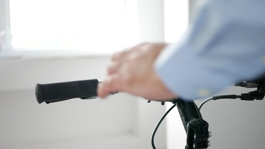 Man in a Sports Shop Test and Verify a Bicycle for Sale | Shutterstock HD Video #1024139213