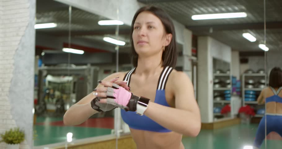 Portrait of a spectacular brunette is training at sport club. | Shutterstock HD Video #1024141643