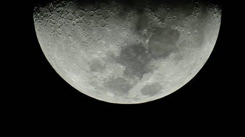 Closeup of moon moving in the night sky
