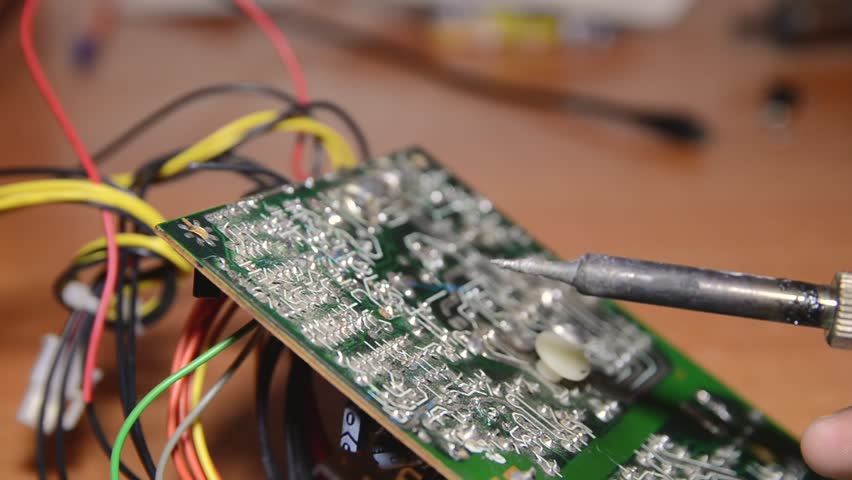 Repair of electronic devices, soldering parts. The master solders, repairs the board. | Shutterstock HD Video #1024155293