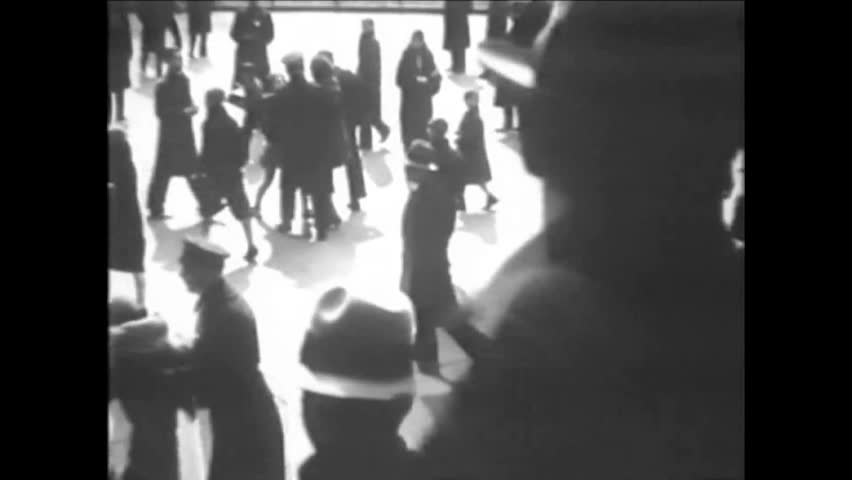 CIRCA 1920s - Black and white footage police raid of a communist protest in the 1920's. #1024161323