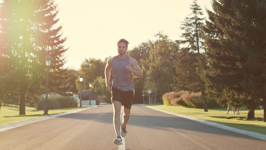 Male runner training to run marathon in park at sunset. Sport man exercise outdoor. Young man training in summer park #1024182803