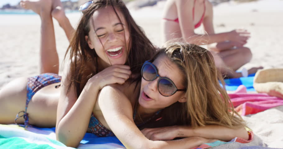 Close up portrait of teenage girl friends hugging each other on vacation #10242083