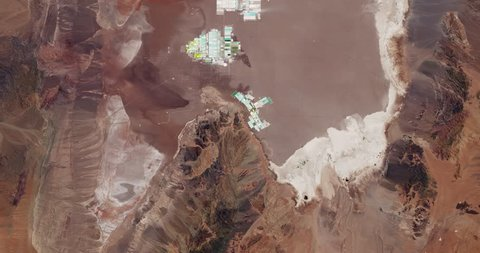 Very high-altitude overflight aerial of lithium evaporation ponds in Chiles' Salar de Atacama. Reversible, seamless loop. Elements of this image furnished by NASA.